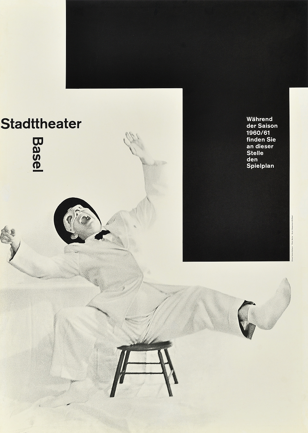 photographic poster of a man in a white costume laughing exaggeratedly on a small wooden chair
