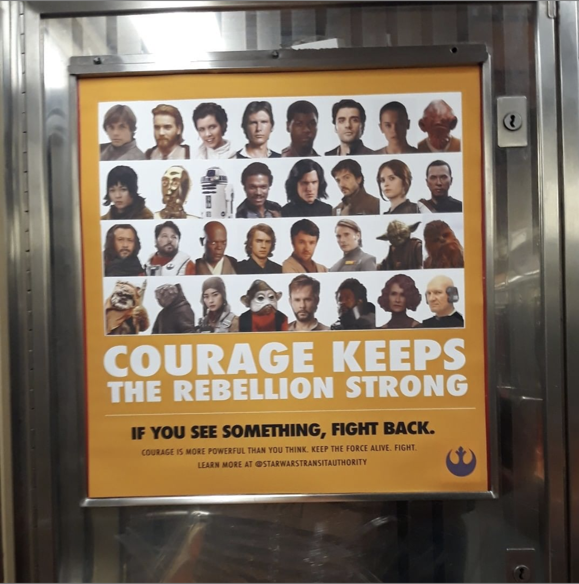 poster inside an MTA subway cart featuring the cast from the Star Wars films titled
