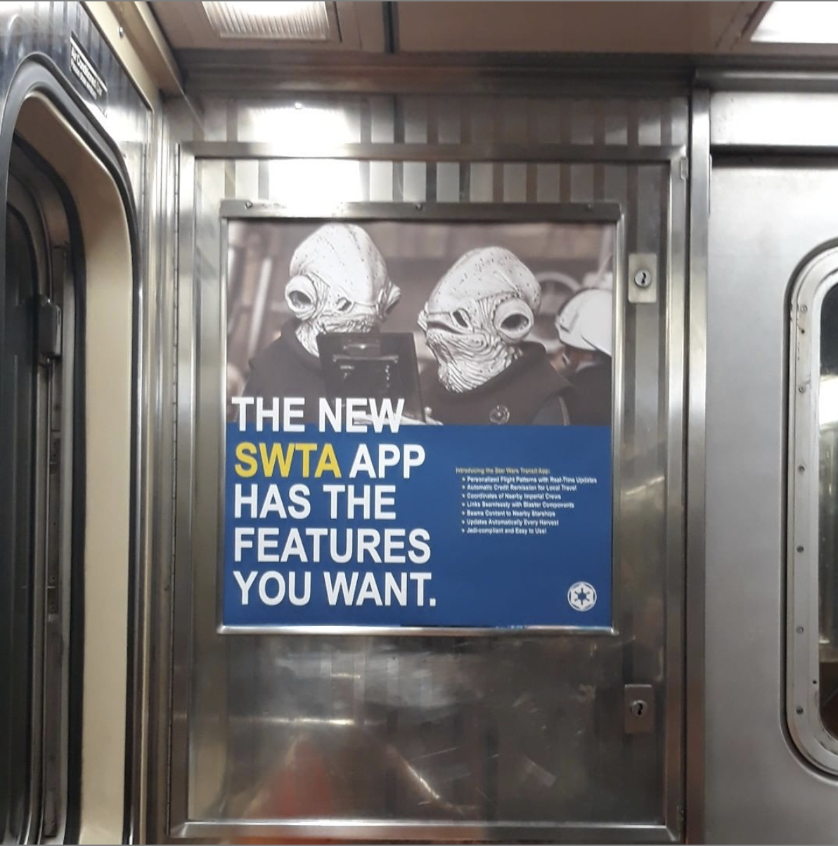 poster inside of an MTA subway cart of creatures from the Star Wars films