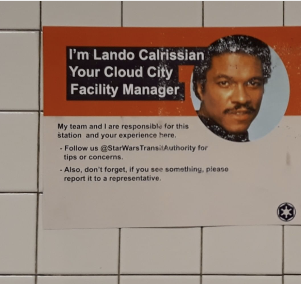 poster inside of an MTA subway station with an image of a black man titled