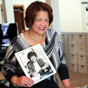 photograph of author Cheryl D Miller holding a photograph