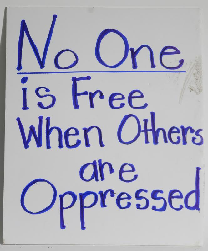 hand drawn poster stating no one is free when others are oppressed