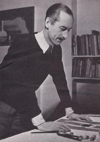 black and white photo of a man leaning over a desk