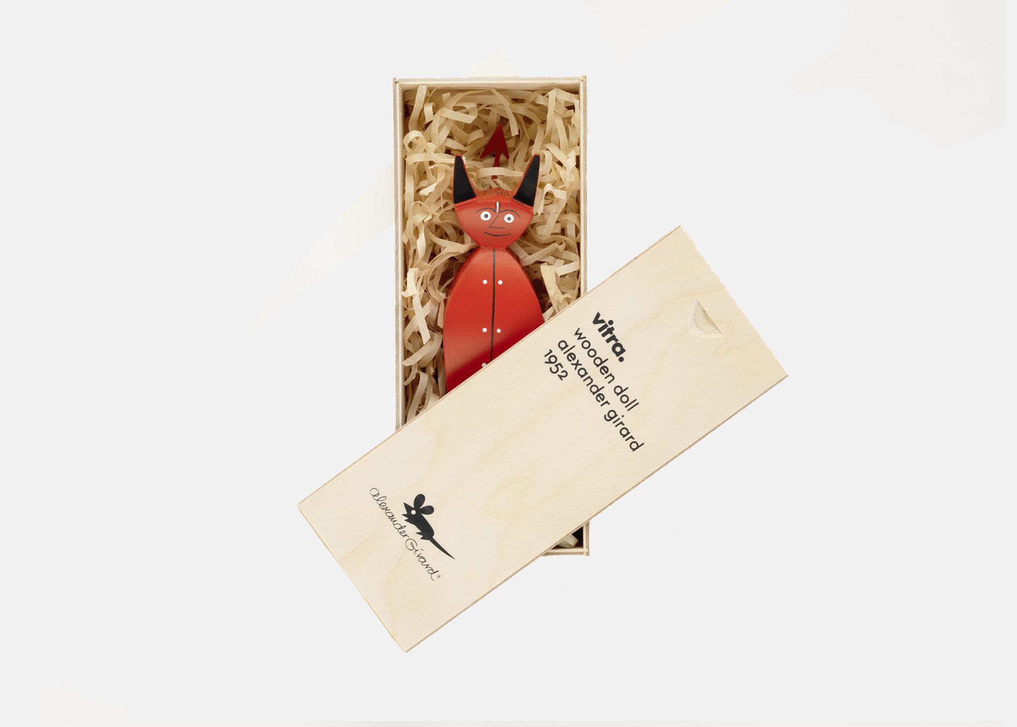 an image of a red devil figurine inside a casket