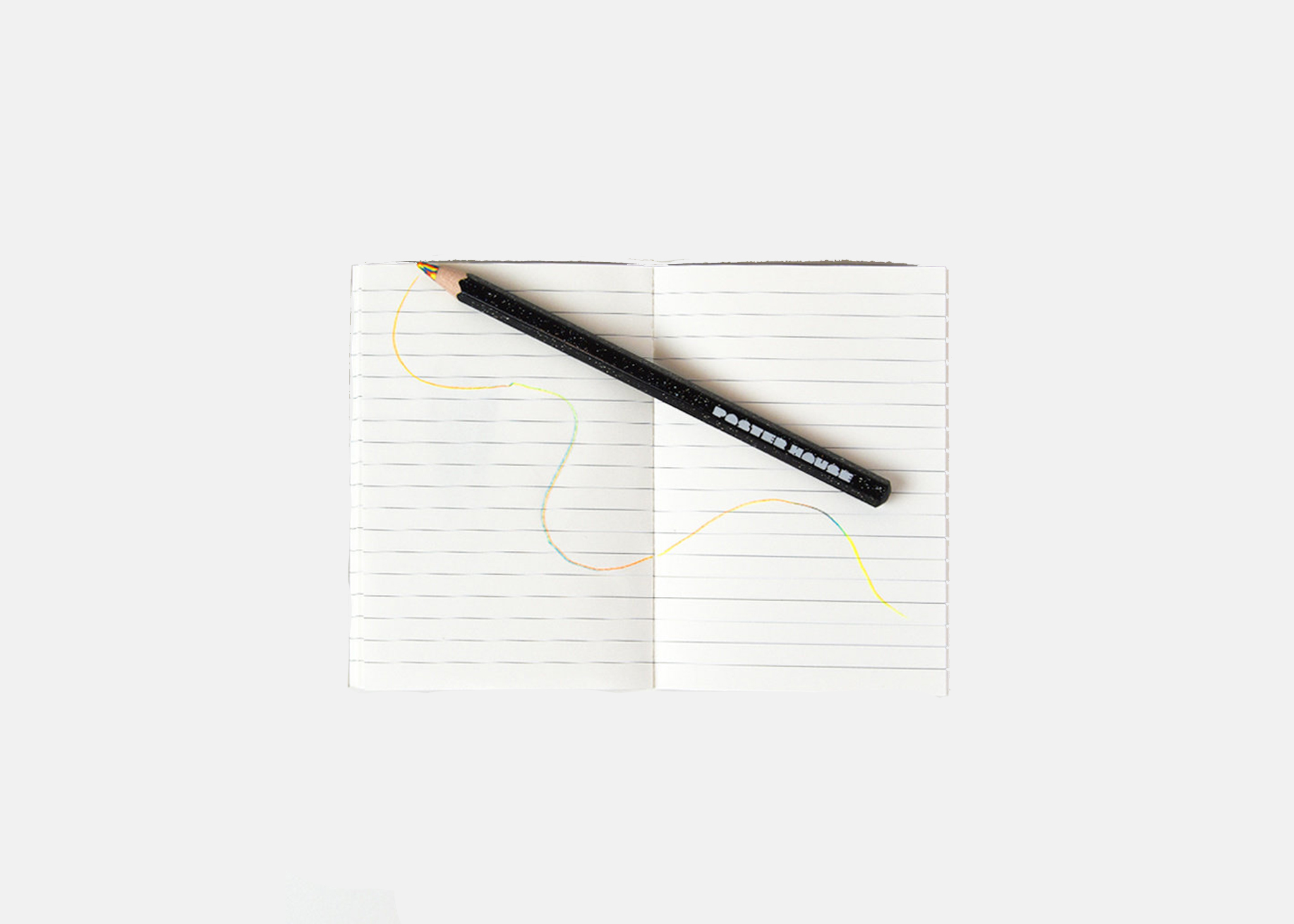 an image of a notebook and the magic pencil scribbled on it