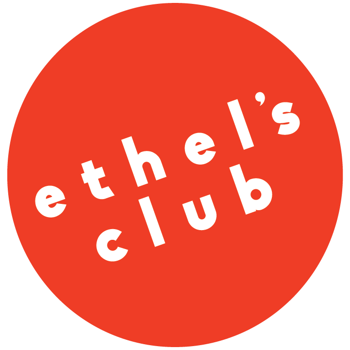 Red Circle with Ethel's Club in white text at an angle.
