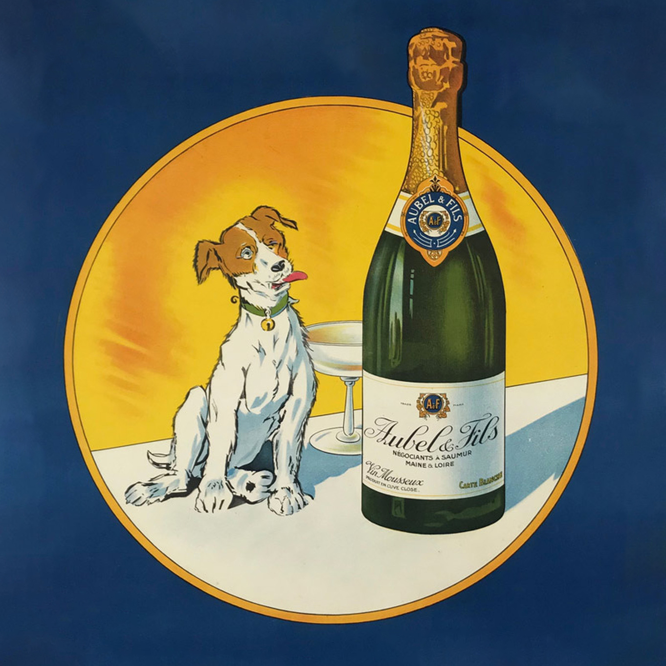 Image of a dog sitting near the bottle of champaign set in a circle on a navy background