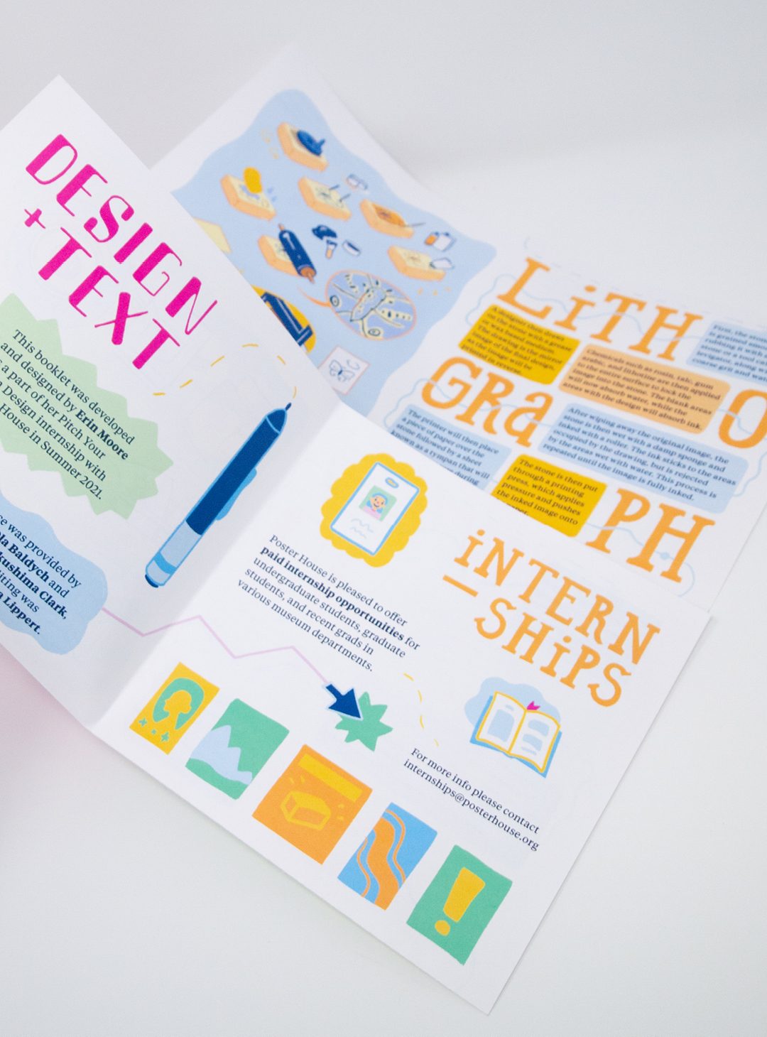 Photo of the 1st step of the poster being unfolded, a spread with the titles