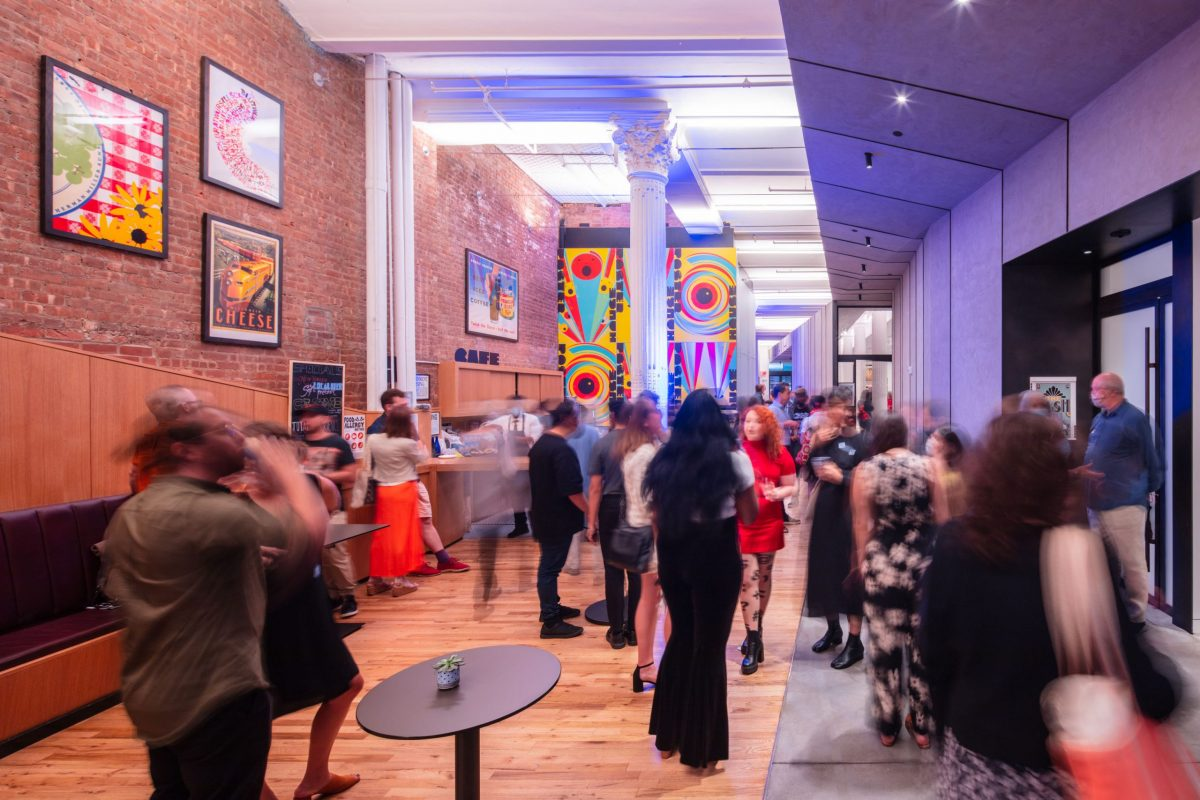 photo of a large crowd of well dressed artsy people attending a party at Poster House